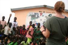 Peace Corps volunteer Lauren Corke with deaf students at her school.