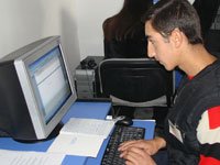 Photo of student Vahe Kolokyan, taken at the Computer Lab during the opening ceremony.
