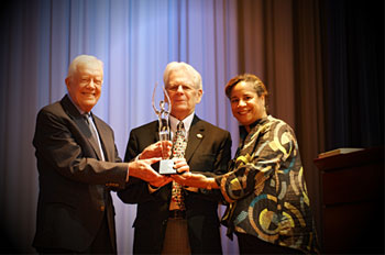 Lillian Carter Award winner John F. Jack Campbell with former President Jimmy Carter and Peace Corps Chief of Staff Laura Chambers