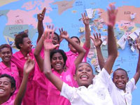 Students in Fiji celebrate the completion of their World Map Project wall mural.