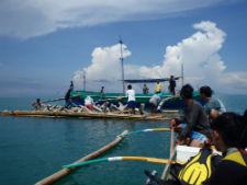 Fishermen deploying the artificial reef.