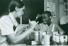 A deaf education Peace Corps volunteer working with youth in Antigua during the '60s.