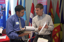A returned Peace Corps volunteer speaks with a recruiter at the Peace Corps career fair in Washington, D.C.