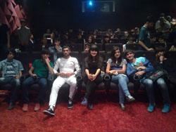 Festival participants watch a film screening.