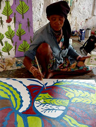 An artist painting at the local center.