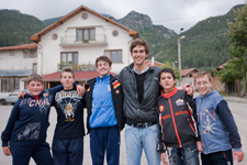 A volunteer in Bulgaria leads a group of kids on a photo scavenger hunt through their village.