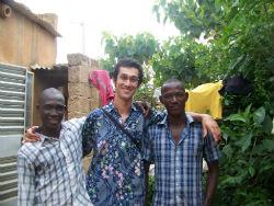 Peace Corps volunteer Bilin Basu with members of his community in Burkina Faso.