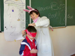 Peace Corps volunteer Cheryl Pratt plays a Halloween game with students.