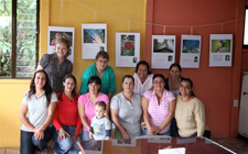 Peace Corps/Costa Rica volunteer Rebecca Stumpf with women who participated in the community photo exhibit commemorating International Womens Day.