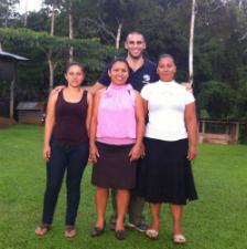 Volunteer Farid Mozafari and women
