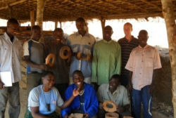 Participants at a Peace Corps volunteer-led training on the use and production of fuel efficient cook stoves.