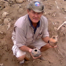 Peace Corps volunteer Greg Plimpton with artifacts from the burial site.