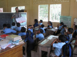 Peace Corps volunteer Travis Weber teaches students in his Guyanese community.