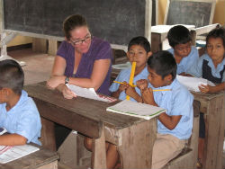Peace Corps volunteer Harmony Hill teaches students in her Guyanese community.