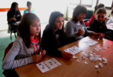 Macedonian students participate in Halloween bingo.