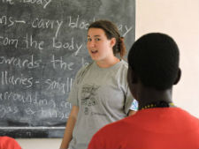Peace Corps volunteer leading a camp Girl Tech session.