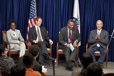Returned Peace Corps volunteer Kiva Wilson (El Salvador, 2004-2006), Department of State Presidential Management Fellow Rennie Silva, Peace Corps Director Aaron S. Williams, and Sen. Harris Wofford participate in a panel discussion at Peace Corps headquarters.