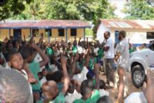 Volunteer Kory Funk leads a talk on malaria in Tanzania