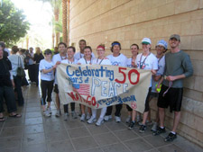 The Peace Corps Jordan team and Country Director Alex Boston pose for a picture after completing the race.