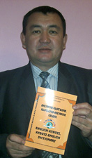 Author Baktybek Kurmanakunov with the dictionary.
