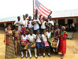 Peace Corps volunteer Charlene Espinoza with members of the Liberian girls club.