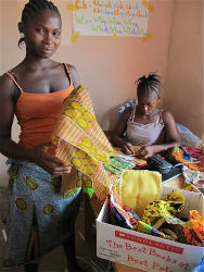 Members of the Liberian girls club select textile scraps for purses.