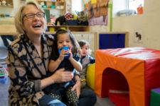 Peace Corps Director Carrie Hessler-Radelet visits children at Barbara Chambers Children's Center