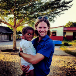 Peace Corps volunteer Patrick Spencer with a child in Madagascar.