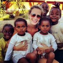 Peace Corps volunteer Raegan Spencer with children in Madagascar.
