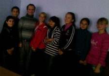 Peace Corps volunteer Thomas Reade with seventh grade students in Moldova.