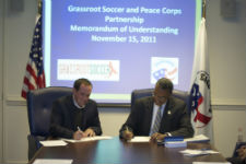 Peace Corps Director Aaron S. Williams and Grassroot Soccer Co-Founder and Africa Executive Director Kirk Friedrich sign the MOU at Peace Corps headquarters.