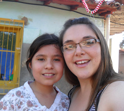 Peace Corps volunteer Sandra Rose Wildermuth with a local youth.