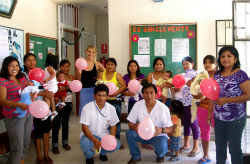 "Peace Corps volunteer Elizabeth Salerno with participants of the ""Life Guidance for Adolescent Mothers"" program."