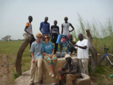 Peace Corps/Senegal volunteers Garrison Harward and Marcie Todd with local community members in front of one of the new pumps they installed.