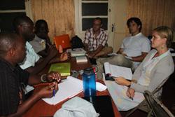 Participants work on a survey about bed net usage.