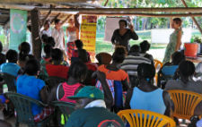 Peace Corps volunteers and a local women's organization lead an entrepreneurship session in Suriname.