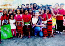Peace Corps volunteer Kelsey Brannock with youth in her community.