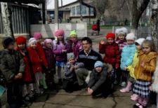 Peace Corps volunteer Joseph Miller with kindergarten students in Ukraine.