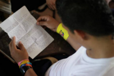 A Young Nicaraguan Reads a Letter from His Pen Pal