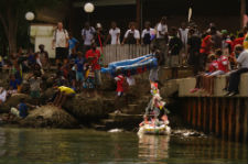 Community members in Peace Corps volunteer Gaea Dill-D'Ascoli's community launch a boat in the trash boat race.