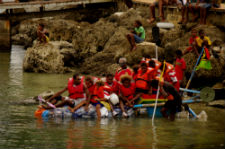 Twelve community members pile onto a boat during the trash boat race.