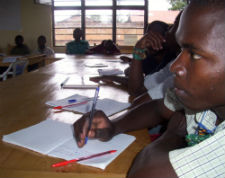 Students learn about malaria during a Boys Excelling (BE) camp in Rwanda.