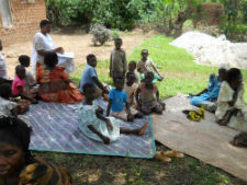 Youth in Uganda learn about malaria during a mobile health clinic session.