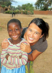 Peace Corps volunteer Allegra Panetto with one of her neighbors in Malawi.
