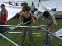 Peace Corps volunteers help to assemble a UNICEF tent village for victims of a mudslide in Uganda.
