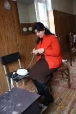 A BWRCF member knitting a Berd Bear.