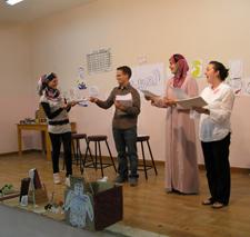 Peace Corps volunteers James Garrett and Shaylyn Romney Garrett conducting a Brain Camp in Jordan.