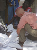 Christopher Brown, a Peace Corps Volunteer in Senegal, helps distribute mosquito nets.
