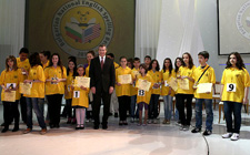 US Ambassador to Bulgaria James Warlick with spelling bee contestants. Peace Corps volunteers in Bulgaria helped prepare the students for the competition.