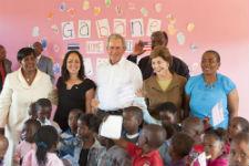 President Bush, former First Lady Laura Bush, Peace Corps volunteer Tija Danzig (left of Bush), and Gabane Center staff and children (Courtesy of the Bush Center).